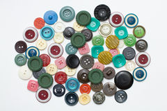 Heap sewing color buttons on white Stock Images