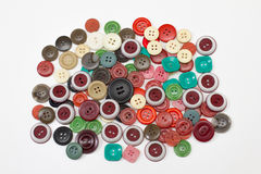 Heap sewing color buttons on white Royalty Free Stock Image