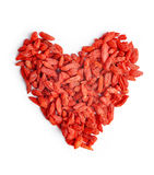 Heap in the shape heart of goji berries Stock Images