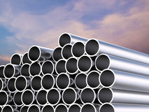 Heap of shiny metal pipes. 3d rendering heap of shiny metal pipes with twilight sky background Royalty Free Stock Photo