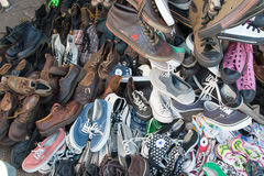 Heap of shoes. Shoes at Sunday market in Bangkok, Thailand Stock Photo