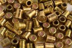 Heap of shotgun primers, closeup Stock Photos