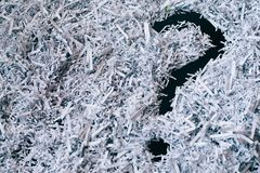 Heap of shredded paper with a symbol of question mark. Concept of Questions and secret royalty free stock photos