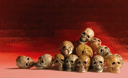 Heap of skulls. Pile of aged skulls in a firey setting Stock Image