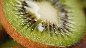 Heap of sliced kiwi. Heap of fresh sliced kiwi fruits with drop of juice. Closeup macro shot. Fresh berry series stock footage