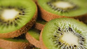 Heap of sliced kiwi. Heap of fresh sliced kiwi fruits rotating. Closeup macro shot. Fresh berry series. 4k stock video footage