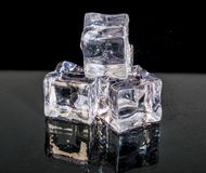 Heap of a small white and transparent ice cubes isolated on the black background Stock Photography