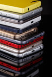 Heap of smartphones. Heap of electronical devices close up - smartphones on black background Stock Image