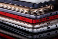 Heap of smartphones. Heap of electronical devices close up - smartphones on black background Stock Photography
