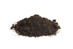 Heap of soil humus,  on a white background. Pile black earth. Stock Photos