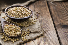 Heap of Soy Beans. On wooden background Stock Photos