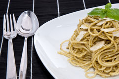 Heap of spaghetti with fresh pesto Stock Photography