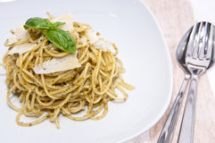Heap of spaghetti with pesto on a plate Stock Images