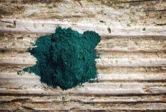 Heap of spirulina algae powder Royalty Free Stock Photos