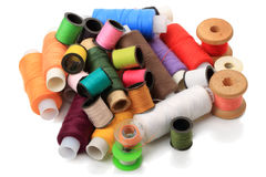 Heap spools of sewing threads Stock Images