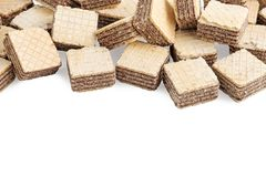 Heap square wafer biscuits isolated on white background royalty free stock photography