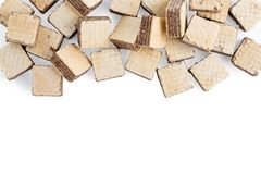 Heap square wafer biscuits isolated on white stock photo