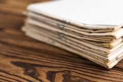 Heap of stacked newspapers stock photography