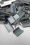 Heap Of Staple Pins. Over grey background Royalty Free Stock Image