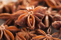 Heap of star anise on a wooden table stock photo