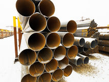 Heap of steel pipes in outdoor warehouse Stock Photography