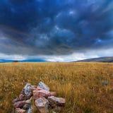 Heap of stone under a dark sky Royalty Free Stock Photo
