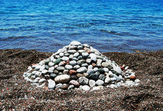 Heap of stones. Stack of stones on the beach of mediterranean sea Royalty Free Stock Image