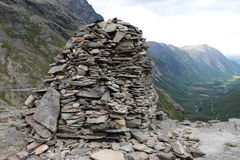 The heap of stones is a sign of conquest the mountain. Royalty Free Stock Photography