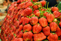 Heap of Strawberries. A heap of fresh strawberries on display in a market Stock Images