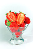 A heap of strawberries in a glass bowl Royalty Free Stock Image