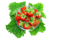 A heap of  strawberries in glass bowl. Isolated Stock Photo
