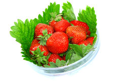A heap of  strawberries in glass bowl. Isolated Stock Image