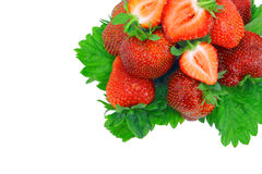 A heap of strawberries on green foliage. Isolated Royalty Free Stock Image