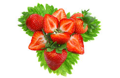 A heap of strawberries on green foliage. Isolated Stock Images