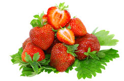 A heap of strawberries on green foliage. Isolated Royalty Free Stock Images