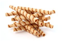 Heap of striped wafer tubules with the chocolate cream, isolated Stock Photo
