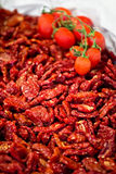 Heap of sundried tomatoes with fresh tomatoes Stock Photo