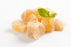 Heap of sweat Candied ginger on white background. Heap of sweat Candied ginger on white background Stock Photography