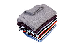 Heap of  sweaters on a white. Royalty Free Stock Photography