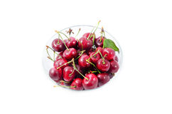 Heap of sweet cherries in a glass bowl. Isolated on white Stock Image