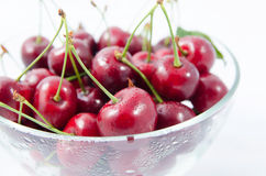 Heap of sweet cherries in a glass bowl Royalty Free Stock Images