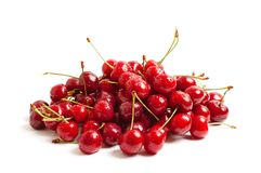 Heap of sweet cherries. Heap of sweet shiny cherries, isolated on white Royalty Free Stock Photography