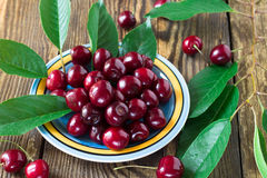 Heap of sweet cherries. On wooden background Royalty Free Stock Images