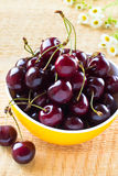 Heap of sweet cherries in the yellow bowl Stock Photo