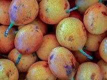 A heap of sweet granadillas stock images