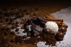 Heap of sweets, chocolate, coffee and spices Stock Photos