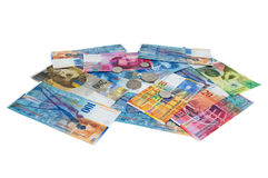 Heap of swiss franc banknotes and coins on white background Royalty Free Stock Photos