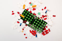 Heap of tablets and pills on white background. Royalty Free Stock Images
