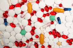 Heap of tablets and pills on white background. Stock Photo