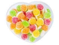 Heap tasty fruit candy lie on plate Royalty Free Stock Images